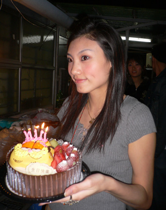 Meeco with her cake