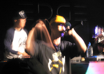 Chef spittin' lyrics in Cantonese, while Qbert spins
