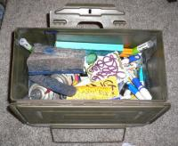 the ammo box filled with graff tools