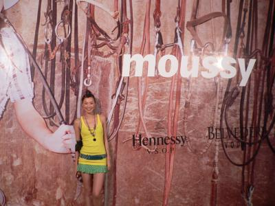 Carrie holding up the wall at the Moussy show
