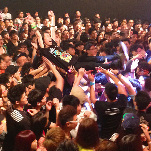 crowd surfing girl hk punk show hardpack concert